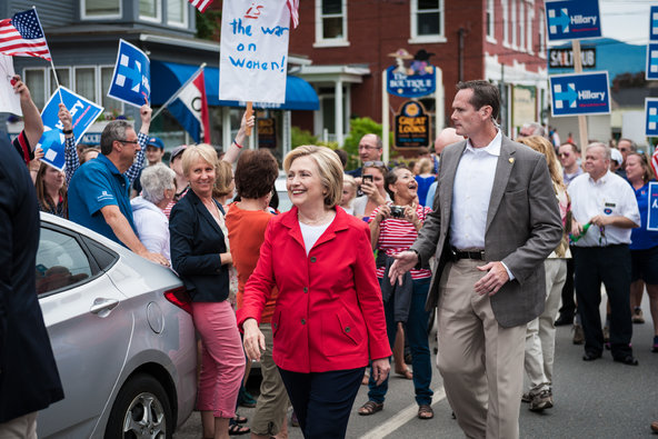 Clinton takes part in a New Hampshire Independence Day Parade