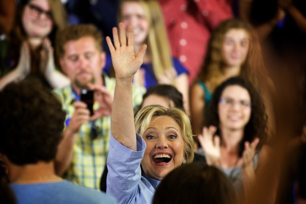 Hillary Clinton waves to supporters during a campaign event on Friday, Sept. 18, at King Middle School in Portland.