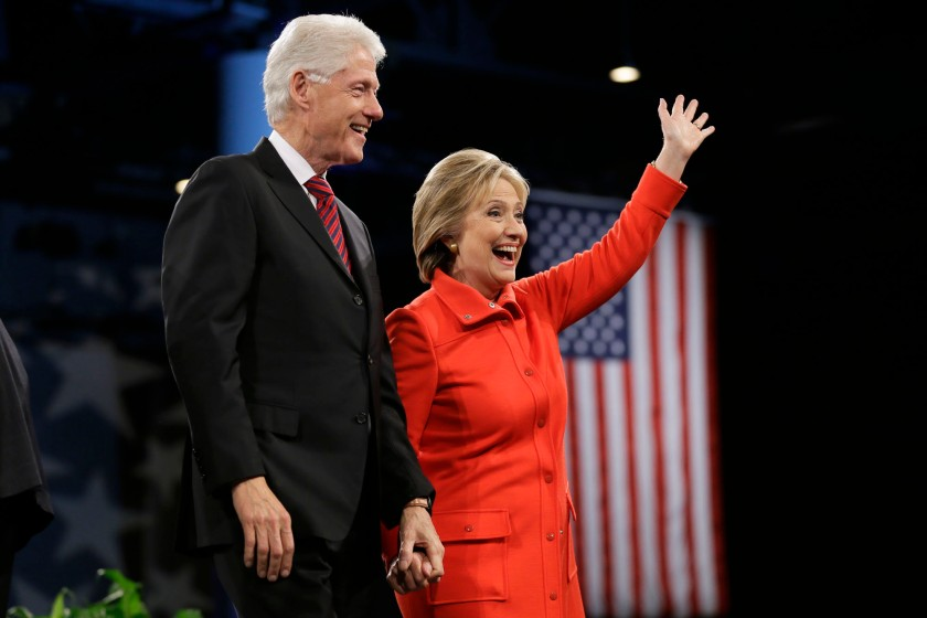Former President Bill Clinton and his wife, Democratic presidential candidate Hillary Rodham Clinton, wave to supporters after the Iowa Democratic Party's Jefferson-Jackson fundraising dinner, Saturday, Oct. 24, 2015, in Des Moines, Iowa. (AP Photo/Charlie Neibergall)