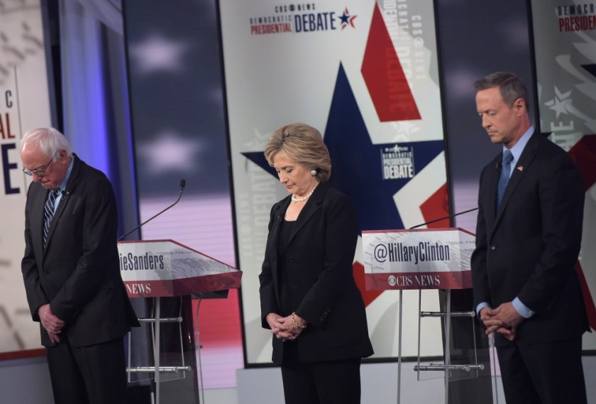 (L-R) Democratic Presidential hopefuls Bernie Sanders, Hillary Clinton, and Martin OMalley pause for a moment of silence, for the victims of the Paris terrorists attacks, before the start of the second Democratic presidential primary debate in the Sheslow Auditorium of Drake University on November 14, 2015 in Des Moines, Iowa. AFP PHOTO/ MANDEL NGANMANDEL NGAN/AFP/Getty Images ORG XMIT: 584876355 ORIG FILE ID: 546404591