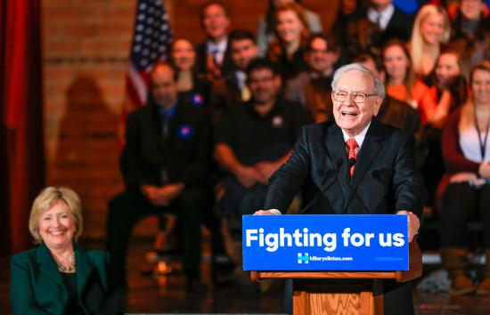 Democratic presidential candidate Hillary Clinton laughs as billionaire investor Warren Buffett speaks at a Clinton Grassroots Organizing Event in Omaha, Nebraska, Decenber 16, 2015.