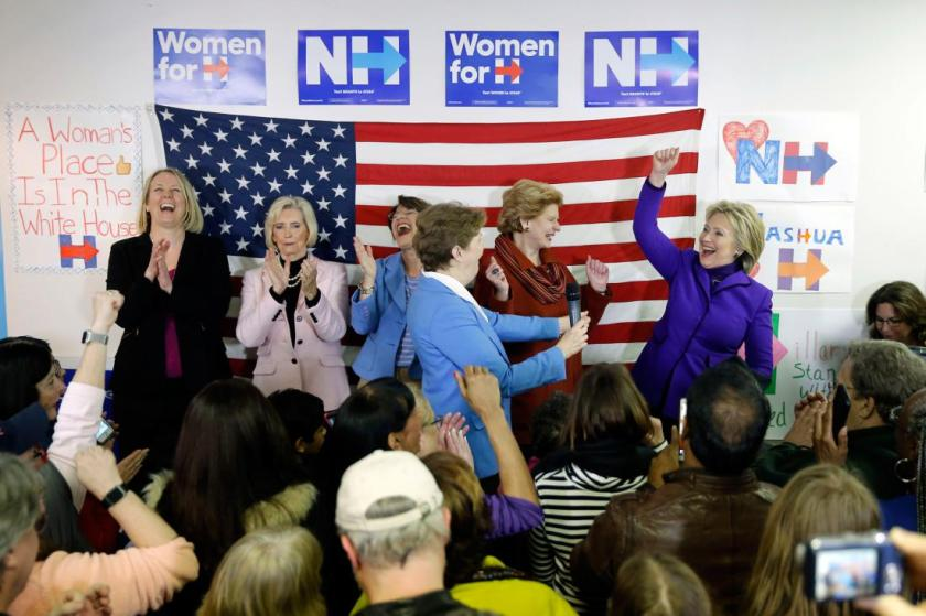 Democratic presidential candidate Hillary Clinton, right, is joined on staged EMILY's List President Stephanie Schriock, left, Lily Ledbetter, Sen. Amy Klobuchar, D-Minn., Jeanne Shaheen, D-N.H., and Sen. Debbie Stabenow, D-Mich., during a visit to a campaign office Friday, Feb. 5, 2016, in Nashua, N.H. (AP Photo/Matt Rourke)