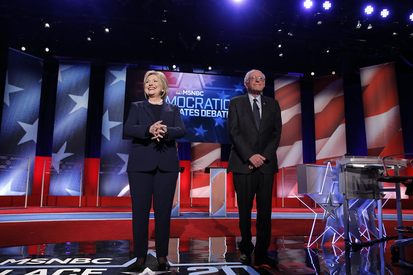 Democratic U.S. presidential candidates Hillary Clinton (L) and Bernie Sanders stand on stage before the start of the Democratic presidential candidates debate sponsored by MSNBC at the University of New Hampshire in Durham, New Hampshire, February 4, 2016.  REUTERS/Carlo Allegri  - RTX25ISR
