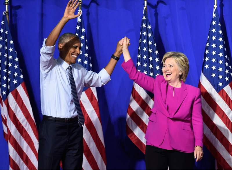 President Barack Obama and Hillary Clinton appear at a campaign event in Charlotte, North Carolina on July 5, 2016.